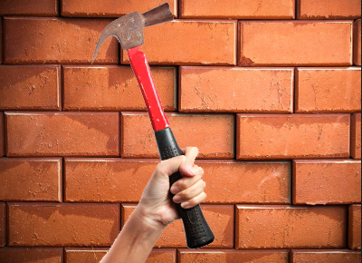 How to break a brick wall
