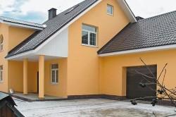 Дом из пеноблока отделанный штукатуркой